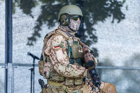 AUGUSTDORF / GERMANY - JUNE 15, 2019: German KSK soldier walks on a stage at Day of the Bundeswehr 2019.