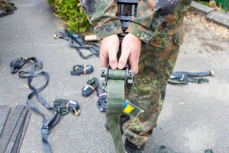 German army soldier holds a lashing ratchet Stock Photo