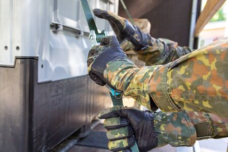German army soldier lashed cargo with lashing material Stock Photo