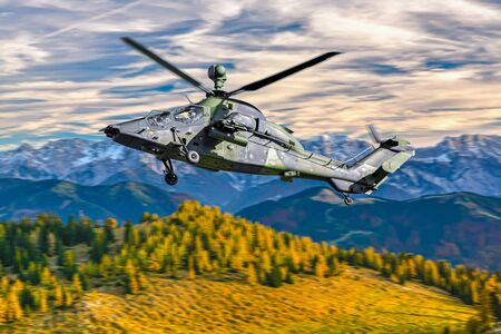 German military armed attack helicopter in flight Standard-Bild - 129365941