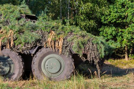 Armoured personnel carrier from german army stands in a military training area