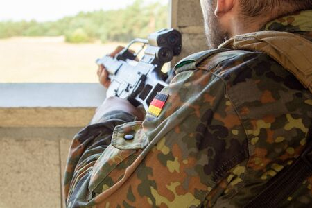 German soldier with a gun at military training area