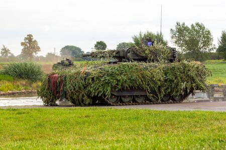 army infantry fighting vehicle drives on tactical exercise at military training area