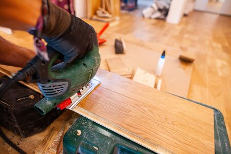 Installing parquet in a floor house room Фото со стока