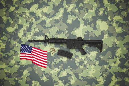 American caliber 5.56 mm rifle on camouflage background