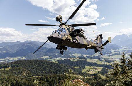 German attack helicopter flies over german landscape