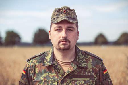 German soldier portrait in front of an field Standard-Bild - 152344176