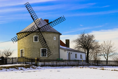 An old and historic wind mill used in past century in Jednov village, Hana region near Olomouc and Prostejov. Stock Photo