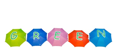 Multi colored umbrella arrangement of green word in white background  photo