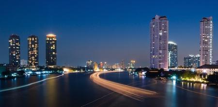 Traffic at night, View Point on a Taksin Bridge, Bangkok, Thailand photo