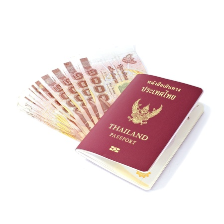 Thailand passport and Thai money on white background Stock Photo - 12878611