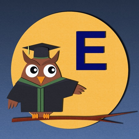 The alphabet  E  and graduates owl, paper cut design  photo
