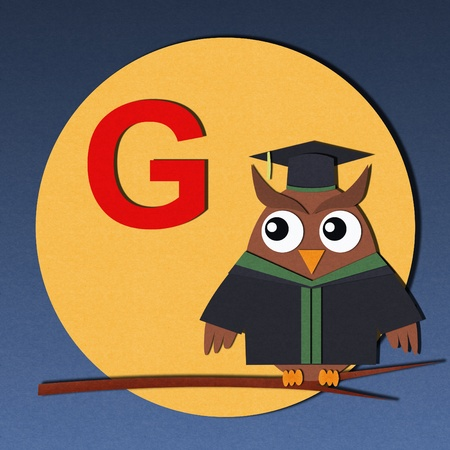 The alphabet  G  and graduates owl, paper cut design  photo