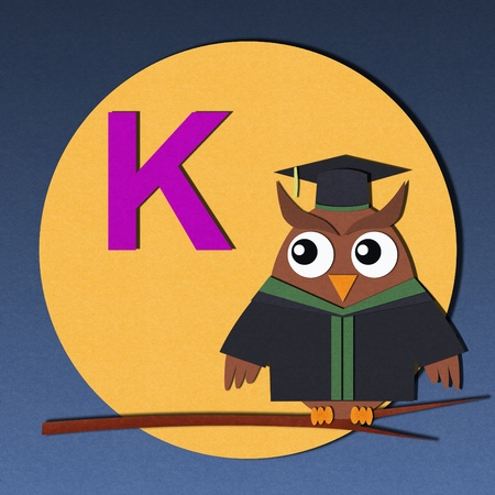 The alphabet  K  and graduates owl, paper cut design  photo