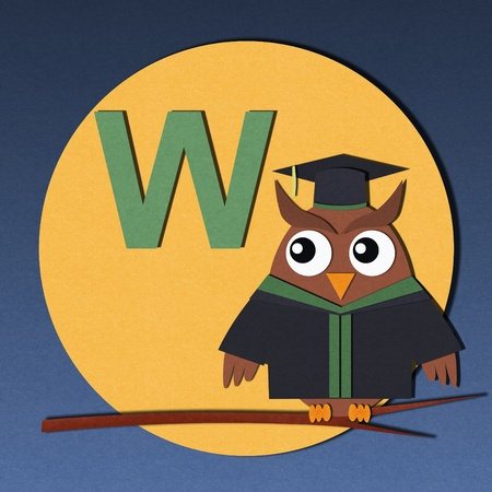 The alphabet  W  and graduates owl, paper cut design  photo