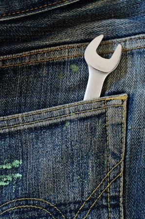 Wrench in a jeans pocket  photo