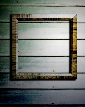 Picture frame on wood wall  Stock Photo - 13766916