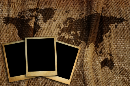 Old photo frame on world map for put  image around the world  photo
