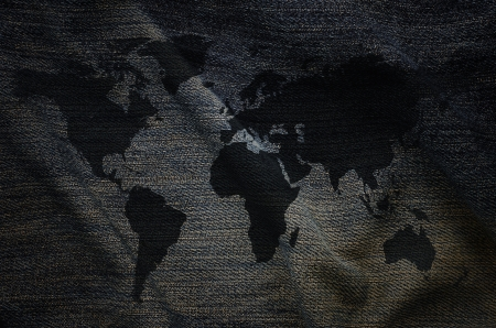 Old world map on jeans  photo