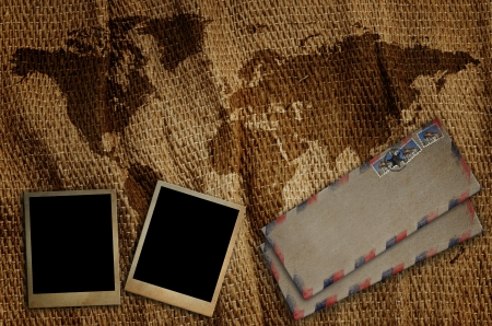 Old envelope and old photo frame put on the old world map  photo