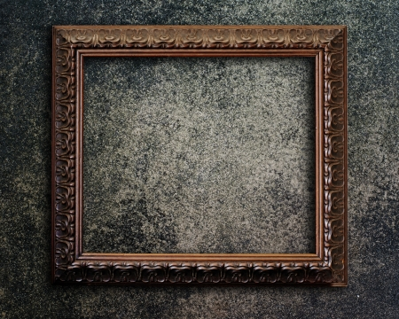 Old Picture frame on grunge wall  photo