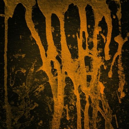 Orange color splash on black background, Grunge background  photo