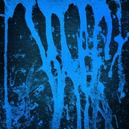 Blue color splash on black background, Grunge background  photo