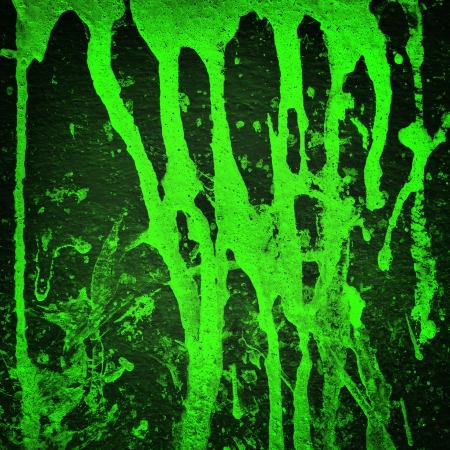Green color splash on black background, Grunge background  photo