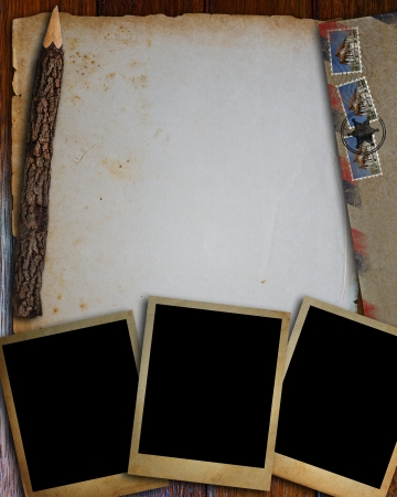 Old envelope, old photo frame, old paper and pencil put on wood table  photo