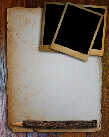 Old photo frame, old paper and pencil put on wood table  photo