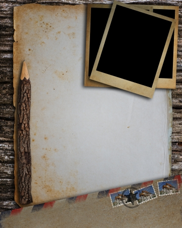 Old envelope, old photo frame, old paper and pencil put on old wood  photo