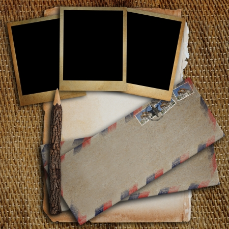Old envelope, old photo frame, old paper and pencil put on a sack  photo