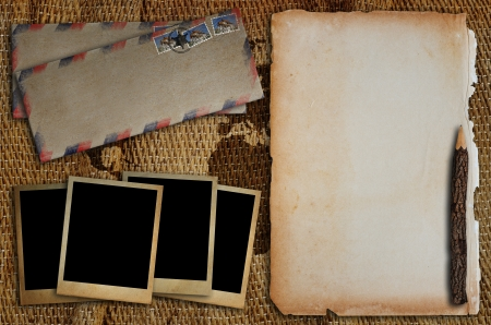 snapshot: Old envelope, old photo frame, old paper and pencil put on a sack