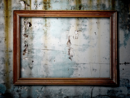 Old picture frame on grunge wall to put your own pictures in  photo