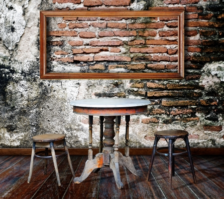 Picture frame and furniture in grunge room Stock Photo - 14686899