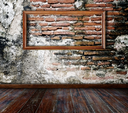 Picture frame put on wall in grunge room Stock Photo - 14688367