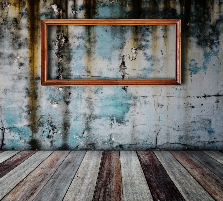Picture frame put on wall in grunge room  Stock Photo - 14686882