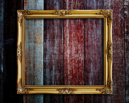 Old picture frame on vintage wood wall  photo