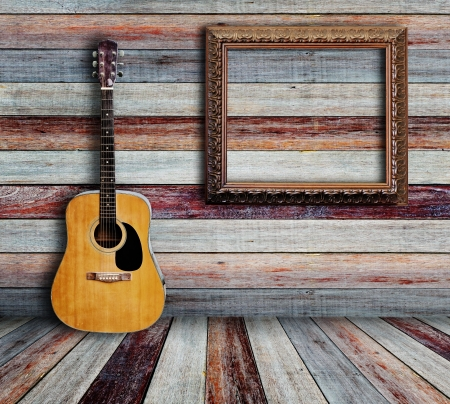 Guitar and picture frame in vintage wood room  Stock Photo - 14783890