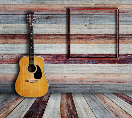 Guitar and picture frame in vintage wood room  photo
