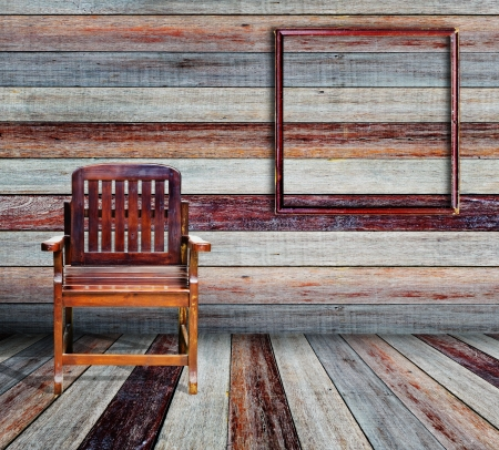 Picture frame and wood chair in grunge room  Stock Photo