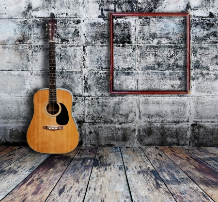 Guitar and picture frame in grunge room Stock Photo - 15190925