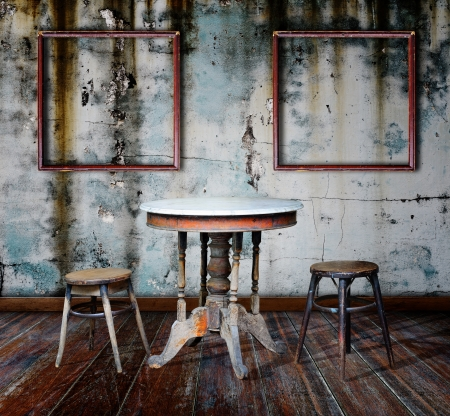 antique furniture: Picture frame and furniture in grunge room