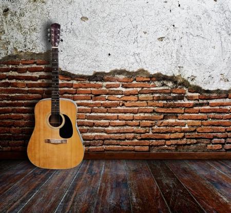 Guitar in grunge room Stock Photo - 15007187