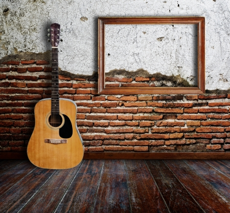 Guitar and picture frame in grunge room Stock Photo - 15007195