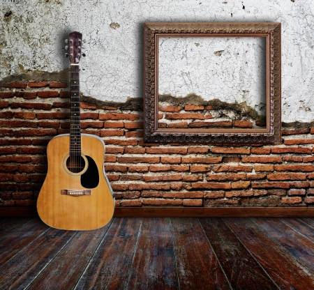 Guitar and picture frame in grunge room Stock Photo - 15007191