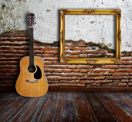 musical background: Guitar and picture frame in grunge room