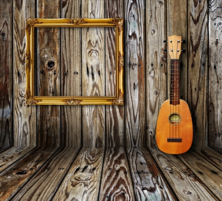 Ukulele and picture frame in vintage wood room. photo