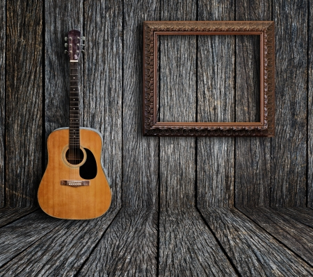 country lifestyle: Guitar and picture frame in vintage wood room