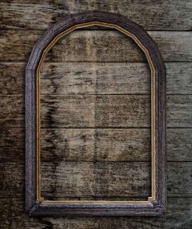wall paper texture: Old picture frame on vintage wood wall. Stock Photo